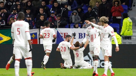 Lille' players celebrate after they scored a goal against Lyon during their French League One soccer match in Decines, near Lyon, central France, Wednesday, Nov. 29, 2017. (AP Photo/Laurent Cipriani)