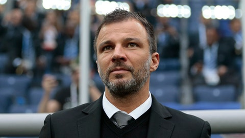 FILE - In this June 17, 2017, file photo, New Zealand coach Anthony Hudson waits for the kick-off of the Confederations Cup, Group A soccer match against Russia the St. Petersburg Stadium, Russia.The Colorado Rapids have hired Hudson as their coach, the MLS soccer club announced Wednesday, Nov, 29, 2017. The 36-year-old Hudson, who is from Seattle, was 9-11-7 as the national team coach of New Zealand. (AP Photo/Ivan Sekretarev, File)