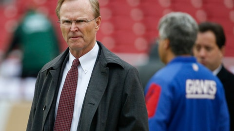 FILE - In this Sunday, Nov. 29, 2015 photo, New York Giants co-owner John Mara walks across the field before an NFL football game against the Washington Redskins in Landover, Md. Co-owner John Mara says there was probably a better way for the New York Giants to handle the benching of two-time Super Bowl MVP Eli Manning after 13 seasons. Speaking for the first time since coach Ben McAdoo announced Tuesday that Geno Smith would start against Oakland, Mara said Wednesday, Nov. 29, 2017 that he made a couple of mistakes in handling the situation.  (AP Photo/Alex Brandon, File)