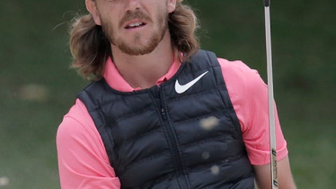 FILE - In this Nov. 25, 2017, file photo, Tommy Fleetwood of England hits a bunker shot on the 15th hole during day three match at the Hong Kong Open golf tournament in Hong Kong. The 26-year-old from England has decided to stay in the Bahamas to get married on Tuesday, Dec. 5, 2017. (AP Photo/Kin Cheung, File)