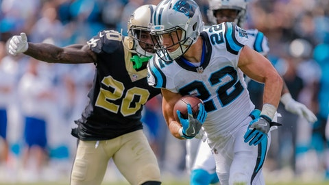 In this Sunday, Sept. 24, 2017 file photo, Carolina Panthers' Christian McCaffrey (22) stays in front of New Orleans Saints' Ken Crawley (20) during the second half of an NFL football game in Charlotte, N.C. The Saints won 34-13. The Panthers are heading into the biggest game of their season with some major injury concerns. Carolina is tied with New Orleans for first place in the NFC South at 8-3 entering a pivotal showdown at the Superdome on Sunday, Dec. 3, 2017 . But just how many Panthers will be available to play remains a mystery. (AP Photo/Bob Leverone, File)