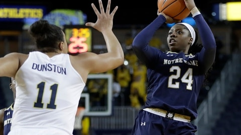 Notre Dame guard Arike Ogunbowale (24) shoots over Michigan forward Jillian Dunston (11) during the first half of an NCAA college basketball game, Wednesday, Nov. 29, 2017, in Ann Arbor, Mich. (AP Photo/Carlos Osorio)