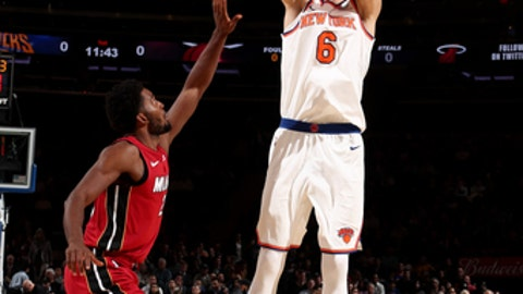 NEW YORK, NY - NOVEMBER 29: Kristaps Porzingis #6 of the New York Knicks shoots the ball during the game against the Miami Heat on November 29, 2017 at Madison Square Garden in New York, New York. NOTE TO USER: User expressly acknowledges and agrees that, by downloading and or using this Photograph, user is consenting to the terms and conditions of the Getty Images License Agreement. Mandatory Copyright Notice: Copyright 2017 NBAE (Photo by Nathaniel S. Butler/NBAE via Getty Images)