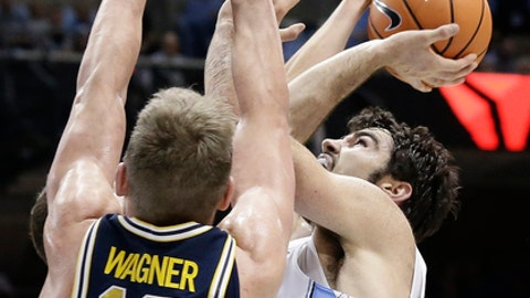 North Carolina's Luke Maye drives to the basket while Michigan's Moritz Wagner (13) defends during the first half of an NCAA college basketball game in Chapel Hill, N.C., Wednesday, Nov. 29, 2017. (AP Photo/Gerry Broome)