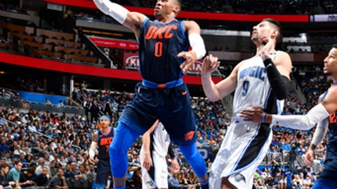 ORLANDO, FL - NOVEMBER 29: Russell Westbrook #0 of the Oklahoma City Thunder goes for a lay up against the Orlando Magic on November 29, 2017 at Amway Center in Orlando, Florida. NOTE TO USER: User expressly acknowledges and agrees that, by downloading and/or using this photograph, user is consenting to the terms and conditions of the Getty Images License Agreement. Mandatory Copyright Notice: Copyright 2017 NBAE (Photo by Fernando Medina/NBAE via Getty Images)