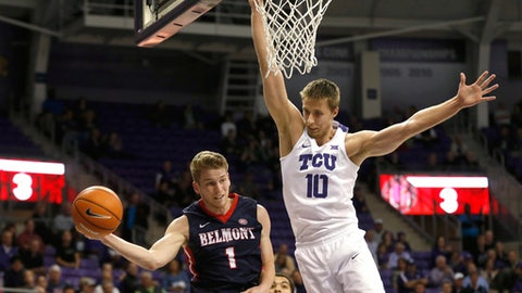 Belmont guard Austin Luke (1) looks to pass the ball around TCU forward Vladimir Brodziansky (10) during the first half of an NCAA college basketball game Wednesday, Nov. 29, 2017, in Fort Worth, Texas. (AP Photo/Ron Jenkins)