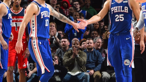 PHILADELPHIA,PA -  NOVEMBER 29 : JJ Redick #17 and Ben Simmons #25 of the Philadelphia 76ers shake hands against the Washington Wizards at Wells Fargo Center on November 29, 2017 in Philadelphia, Pennsylvania NOTE TO USER: User expressly acknowledges and agrees that, by downloading and/or using this Photograph, user is consenting to the terms and conditions of the Getty Images License Agreement. Mandatory Copyright Notice: Copyright 2017 NBAE (Photo by Jesse D. Garrabrant/NBAE via Getty Images)