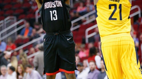 HOUSTON, TX - NOVEMBER 29: James Harden #13 of the Houston Rockets shoots a three point basket over Thaddeus Young #21 of the Indiana Pacers at Toyota Center on November 29, 2017 in Houston, Texas. NOTE TO USER: User expressly acknowledges and agrees that, by downloading and or using this photograph, User is consenting to the terms and conditions of the Getty Images License Agreement.  (Photo by Bob Levey/Getty Images)