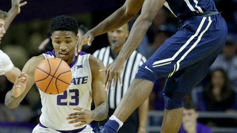 Kansas State's Amaad Wainright (23) and Oral Roberts's Emmanuel Nzekwesi chase a loose ball during the second half of an NCAA college basketball game Wednesday, Nov. 29, 2017, in Manhattan, Kan. Kansas State won 77-68. (AP Photo/Charlie Riedel)