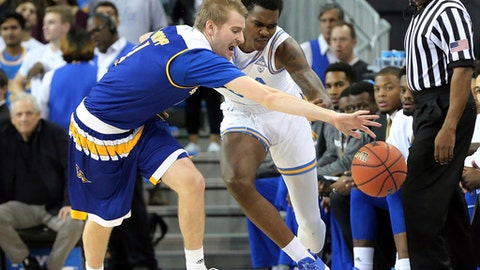 CSU Bakersfield guard Brent Wrapp (1) and UCLA guard Kris Wilkes (13) chase a ball heading out of bounds in the first half of an NCAA college basketball game in Los Angeles, Wednesday, Nov. 29, 2017. (AP Photo/Reed Saxon)