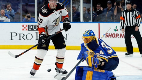 Anaheim Ducks' Corey Perry (10) and St. Louis Blues goalie Jake Allen watch the puck during the third period of an NHL hockey game Wednesday, Nov. 29, 2017, in St. Louis. The Ducks won 3-2. (AP Photo/Jeff Roberson)