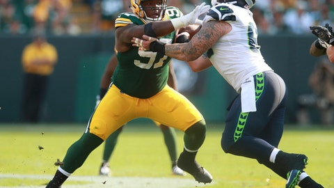 FILe - In this Sept. 10, 2017, file photo, Green Bay Packers nose tackle Kenny Clark (97) rushes in against Seattle Seahawks center Justin Britt (68) during an NFL football game, in Green Bay, Wis. After the missing the first game ever in his football career dating back to high school, Clark is back at practice in hopes of resuming his impressive second NFL season on Sunday against the Tampa Bay Buccaneers .(AP Photo/Jeff Haynes, File)
