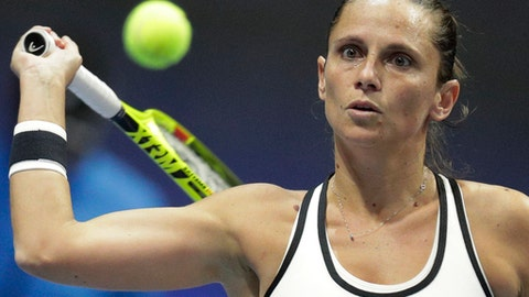 Roberta Vinci of Italy returns the ball to Kristina Mladenovic of France during the St. Petersburg Ladies Trophy-2017 tennis tournament quarterfinal match in St.Petersburg, Russia, Friday, Feb. 3, 2017. (AP Photo/Dmitri Lovetsky)