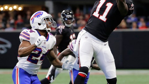FILE - In this Oct. 1, 2017, file photo, Atlanta Falcons wide receiver Julio Jones (11) makes a catch against Buffalo Bills defensive back Leonard Johnson (24) during the first half of an NFL football game, in Atlanta. The Minnesota Vikings could take another big step in their bid to run away with the NFC North on Sunday when they match their seven-game winning streak against the Falcons, who have won three straight.  (AP Photo/David Goldman, File)