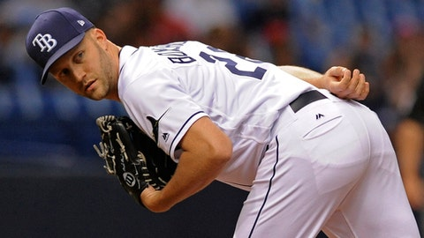 FILE - In this July 21, 2017, file photo, Tampa Bay Rays reliever Brad Boxberger checks a runner at first base during a baseball game against the Texas Rangers in St. Petersburg, Fla.  The Arizona Diamondbacks acquired Boxberger from the Tampa Bay Rays on Thursday, Nov. 30, 2017,  for minor league right-hander Curtis Taylor. (AP Photo/Steve Nesius, File)