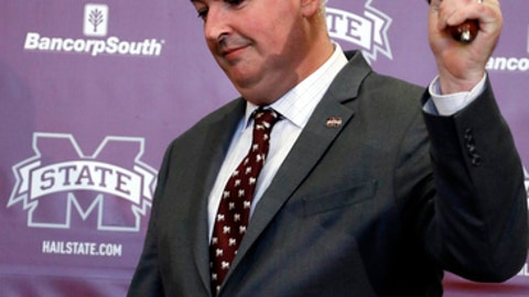 New Mississippi State football coach Joe Moorhead rings the the traditional cowbell prior to addressing reporters and team supporters at his official introduction by the university during an NCAA college football news conference, Thursday, Nov. 30, 2017, in Starkville, Miss. (AP Photo/Rogelio V. Solis)