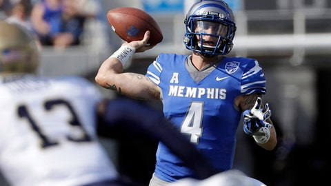 FILE - In this Oct. 14, 2017, file photo, Memphis quarterback Riley Ferguson (4) passes as he is pressured by Navy safety Juan Hailey (13) in the first half of an NCAA college football game, in Memphis, Tenn. Wide receiver Anthony Miller came to Memphis as a local preferred walk-on. Quarterback Riley Ferguson started at the Southeastern Conference school on the other side of the state before Mike Norvell lured him to town. Together, they've helped the 16th-ranked Tigers reach the American Athletic Conference championship against No. 12 UCF with a chance at the program's best season ever.(AP Photo/Mark Humphrey, File)