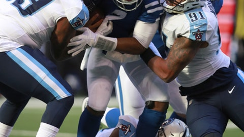 FILE - In this Nov. 26, 2017, file photo, Indianapolis Colts quarterback Jacoby Brissett (7) is sacked by Tennessee Titans defensive end Jurrell Casey (99) and outside linebacker Derrick Morgan (91) during an NFL football game, in Indianapolis. The Titans piled up eight sacks in their last game, the most by this franchise since moving to Tennessee. They hope that's just the tip of what they can do starting Sunday against Houston.(AP Photo/Jeff Haynes, File)