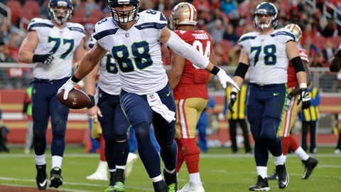 FILE - In this Sunday, Nov. 26, 2017, file photo, Seattle Seahawks tight end Jimmy Graham (88) celebrates after a touchdown reception against the San Francisco 49ers during the second half of an NFL football game in Santa Clara, Calif. Graham is on a run of touchdowns unlike any other point in his three seasons with the Seahawks. He leads NFC tight ends with eight TDs, six coming in the past five games. (AP Photo/Don Feria, File)