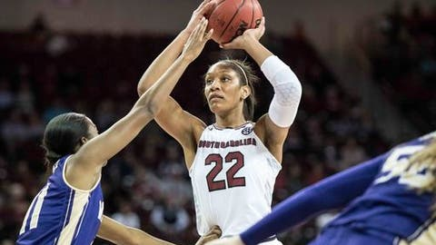 South Carolina forward A'ja Wilson (22) looks for an open teammate as Western Carolina forward Sherae Bonner (11) defends during the first half of an NCAA college basketball game Thursday, Nov. 30, 2017, in Columbia, S.C. (AP Photo/Sean Rayford)