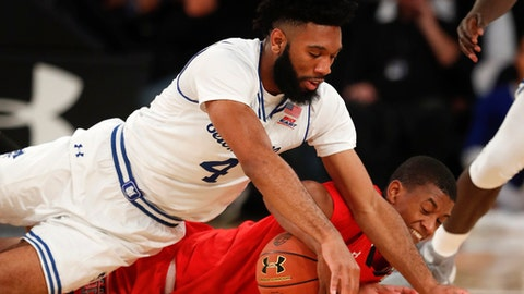 Seton Hall guard Eron Gordon (4) and Texas Tech guard Jarrett Culver scramble for the ball during the second half of an NCAA college basketball game, Thursday, Nov. 30, 2017, in New York. Seton Hall won 89-79. (AP Photo/Julie Jacobson)