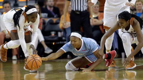 Louisiana Tech forward Reauna Cleaver, center, scramble for a loose ball with Texas guard Lashann Higgs, left, and Texas guard Ariel Atkins, right, during the first half of an NCAA college basketball game, Thursday, Nov. 30, 2017, in Austin, Texas. (AP Photo/Eric Gay)