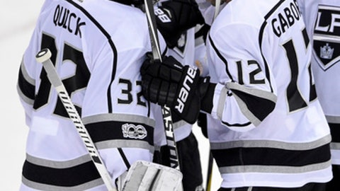 Los Angeles Kings right wing Marian Gaborik (12), of Slovakia, celebrates with goalie Jonathan Quick (32) after an NHL hockey game against the Washington Capitals, Thursday, Nov. 30, 2017, in Washington. The Kings won 5-2. (AP Photo/Nick Wass)