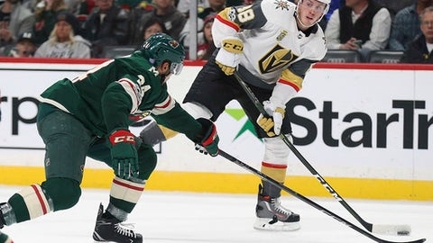 Vegas Golden Knights' Nate Schmidt (88) looks to pass the puck against Minnesota Wild's Matt Dumba (24) in the second period of an NHL hockey game Thursday, Nov. 30, 2017, in St. Paul, Minn. (AP Photo/Stacy Bengs)