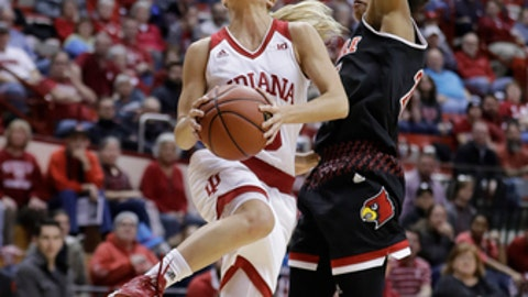Indiana's Tyra Buss goes to the basket against Louisville's Asia Durr during the second half of an NCAA college basketball game, Thursday, Nov. 30, 2017, in Bloomington, Ind. (AP Photo/Darron Cummings)