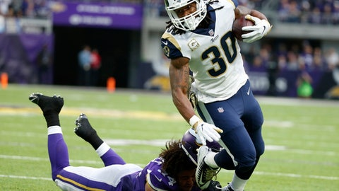 FILE - In this Nov. 19, 2017, Los Angeles Rams running back Todd Gurley (30) runs from Minnesota Vikings middle linebacker Eric Kendricks (54) during the first half of an NFL football game in Minneapolis. While the Los Angeles Rams have been utterly transformed from the NFL's worst offense last year to one of its best this season, there's one area where the Rams are still lacking. When running back Todd Gurley was asked why the Rams mostly aren't participating in the wave of skits and choreographed dances, the NFL's leader in points scored by a non-kicker had an answer that was a celebration in itself. (AP Photo/Bruce Kluckhohn, File)