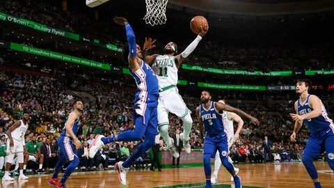 BOSTON, MA - NOVEMBER 30:  Kyrie Irving #11 of the Boston Celtics dunks against Robert Covington #33 of the Philadelphia 76ers on November 30, 2017 at the TD Garden in Boston, Massachusetts.  NOTE TO USER: User expressly acknowledges and agrees that, by downloading and or using this photograph, User is consenting to the terms and conditions of the Getty Images License Agreement. Mandatory Copyright Notice: Copyright 2017 NBAE  (Photo by Brian Babineau/NBAE via Getty Images)