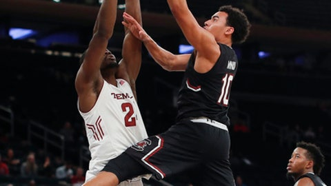 South Carolina forward Justin Minaya (10) shoots against Temple guard Alani Moore II (2) during the second half of an NCAA college basketball game Thursday, Nov. 30, 2017, in New York. Temple won 76-60. (AP Photo/Julie Jacobson)