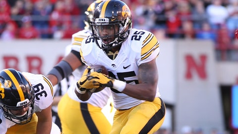 Nov 24, 2017; Lincoln, NE, USA; Iowa Hawkeyes running back Akrum Wadley (25) finds running room against the Nebraska Cornhuskers in the second quarter at Memorial Stadium. Mandatory Credit: Reese Strickland-USA TODAY Sports