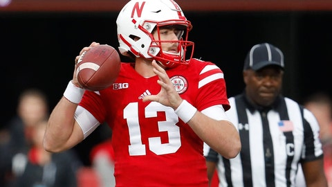 Nov 4, 2017; Lincoln, NE, USA; Nebraska Cornhuskers quarterback Tanner Lee (13) throws against the Northwestern Wildcats in the first half at Memorial Stadium. Northwestern won 31-24. Mandatory Credit: Bruce Thorson-USA TODAY Sports