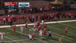 Playoffs, semifinals: Chris Street hurdles a defender for a Mater Dei TD