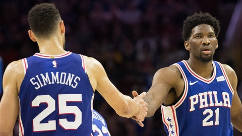 Nov 3, 2017; Philadelphia, PA, USA; Philadelphia 76ers center Joel Embiid (21) and guard Ben Simmons (25) celebrate after scoring against the Indiana Pacers during the fourth quarter at Wells Fargo Center. Mandatory Credit: Bill Streicher-USA TODAY Sports
