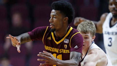 Xavier's J.P. Macura, right, tries to steal the ball from Arizona State's Shannon Evans II during the first period of an NCAA college basketball game Friday, Nov. 24, 2017, in Las Vegas. (AP Photo/John Locher)