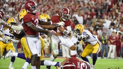 Nov 4, 2017; Tuscaloosa, AL, USA; Alabama Crimson Tide quarterback Jalen Hurts (2) scores a touchdown against the LSU Tigers during the third quarter at Bryant-Denny Stadium. Mandatory Credit: Adam Hagy-USA TODAY Sports