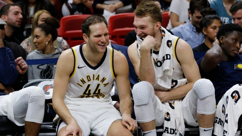 Indiana Pacers forward Bojan Bogdanovic (44) reacts with teammate Domantas Sabonis (11) on the bench after they left  an NBA basketball game in the fourth quarter against the Miami Heat, Sunday, Nov. 19, 2017, in Miami. (AP Photo/Joe Skipper)