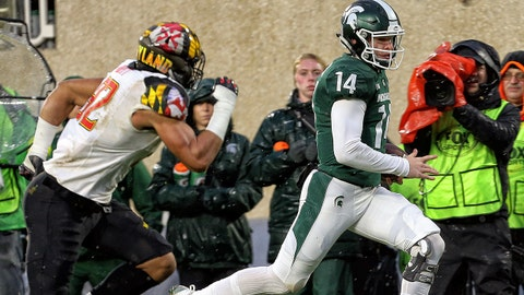 Nov 18, 2017; East Lansing, MI, USA; Michigan State Spartans quarterback Brian Lewerke (14) runs the ball against Maryland Terrapins linebacker Bruce Miller (32) during the first quarter of a game at Spartan Stadium. Mandatory Credit: Mike Carter-USA TODAY Sports