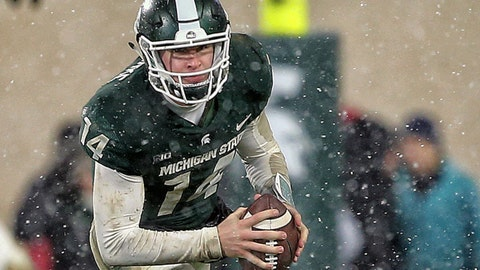 Nov 18, 2017; East Lansing, MI, USA; Michigan State Spartans quarterback Brian Lewerke (14) scrambles out of the pocket during the first half of a game against the Maryland Terrapins  at Spartan Stadium. Mandatory Credit: Mike Carter-USA TODAY Sports