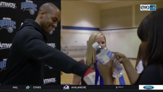 Magic guard Arron Afflalo hands out turkeys to local families