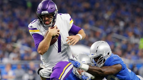 Minnesota Vikings quarterback Case Keenum (7) pulls away from the Detroit Lions defense to score on a 9-yard rush during the first half of an NFL football game, Thursday, Nov. 23, 2017, in Detroit. (AP Photo/Paul Sancya)