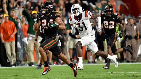 Nov 4, 2017; Miami Gardens, FL, USA; Miami Hurricanes running back Travis Homer (24) runs past Virginia Tech Hokies cornerback Brandon Facyson (31) for a touchdown during the first half at Hard Rock Stadium. Mandatory Credit: Steve Mitchell-USA TODAY Sports