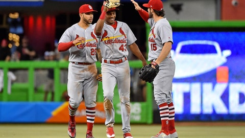 May 9, 2017; Miami, FL, USA; St. Louis Cardinals left fielder Tommy Pham (28) and center fielder Magneuris Sierra (43) and right fielder Randal Grichuk (15) celebrate after defeating the Miami Marlins at Marlins Park. Mandatory Credit: Jasen Vinlove-USA TODAY Sports