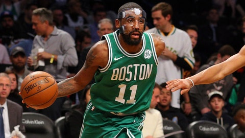 Nov 14, 2017; Brooklyn, NY, USA; Boston Celtics point guard Kyrie Irving (11) drives against Brooklyn Nets point guard Spencer Dinwiddie (8) during the third quarter at Barclays Center. Mandatory Credit: Brad Penner-USA TODAY Sports