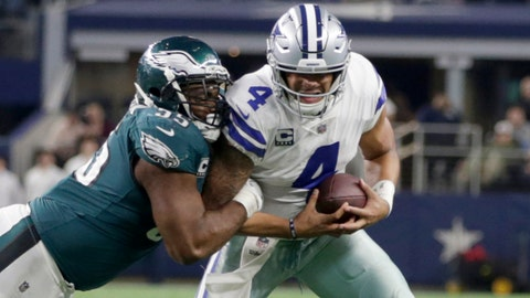 Nov 19, 2017; Arlington, TX, USA; Philadelphia Eagles defensive end Brandon Graham (55) sacks Dallas Cowboys quarterback Dak Prescott (4) in the fourth quarter at AT&T Stadium. Mandatory Credit: Tim Heitman-USA TODAY Sports