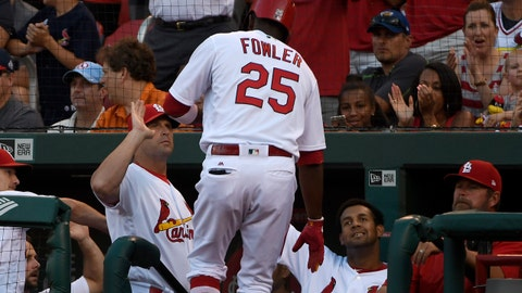 Jun 15, 2017; St. Louis, MO, USA; St. Louis Cardinals center fielder Dexter Fowler (25) is congratulated by manager Mike Matheny (22) after hitting a solo home run off of Milwaukee Brewers starting pitcher Zach Davies (not pictured) during the third inning at Busch Stadium. Mandatory Credit: Jeff Curry-USA TODAY Sports