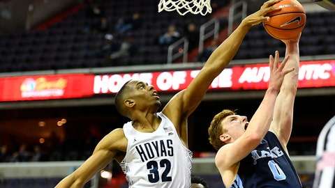 Nov 28, 2017; Washington, DC, USA; Georgetown Hoyas guard Kaleb Johnson (32) blocks the shot by Maine Black Bears forward Andrew Fleming (0) during the second half at Capital One Arena. Mandatory Credit: Brad Mills-USA TODAY Sports