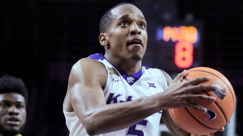 Kansas State guard Barry Brown (5) drives the lane past Northern Arizona defenders Jojo Anderson, left, and Ruben Fuamba (55) during the second half of an NCAA college basketball game in Manhattan, Kan., Monday, Nov. 20, 2017. (AP Photo/Orlin Wagner)